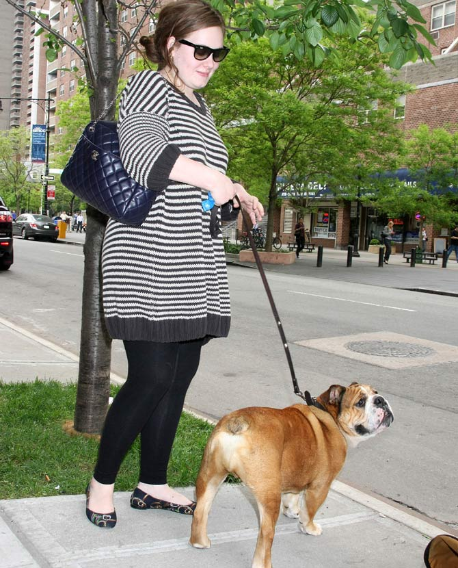 Adele in 2009 with her dog in New York City. Credit: Famous