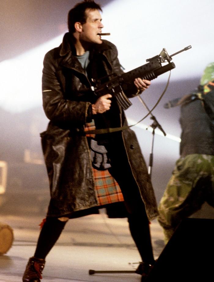 http://www.contactmusic.com/images/feature-images/bill-drummond-the-klf-fires-machine-gun-blanks-brit-awards-pa-4730684.jpg