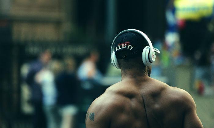 Bodybuilder with headphones