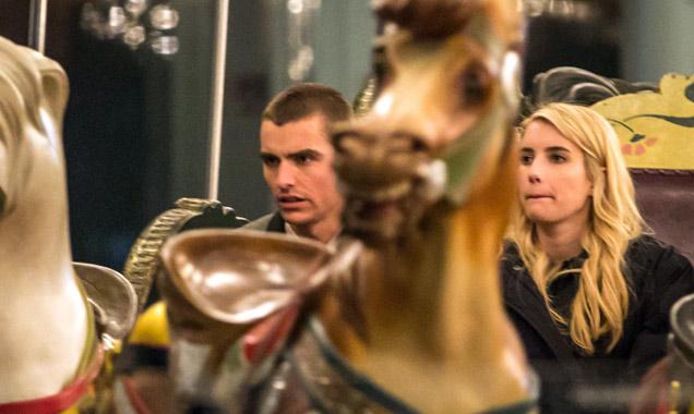 Emma Roberts and Dave Franco at a carousel set