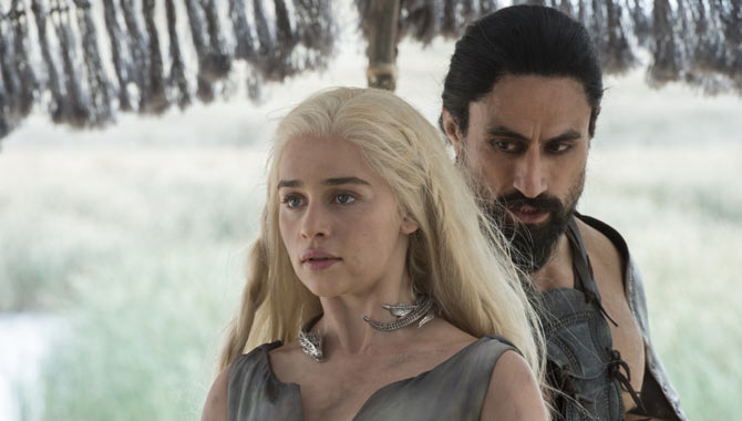 Emilia Clarke and Joe Naufahu in Game of Thrones