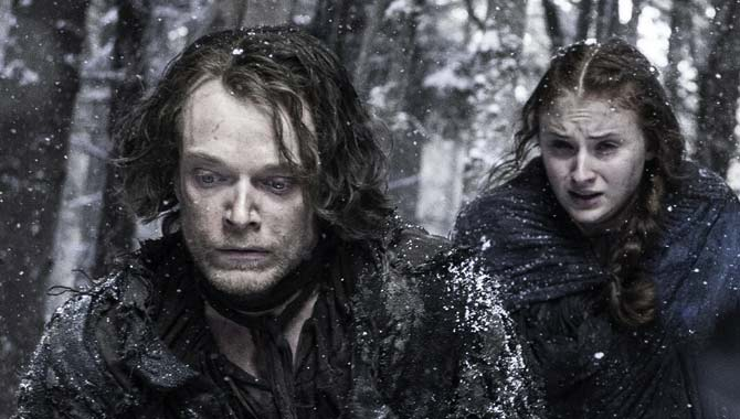Sophie Turner and Alfie Allen in Game Of Thrones