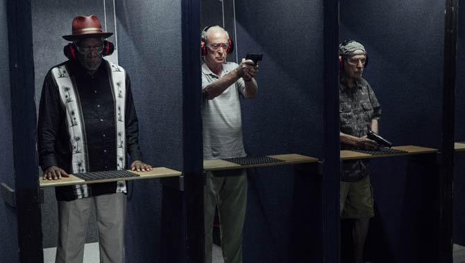 Freeman, Caine and Arkin at the shooting range