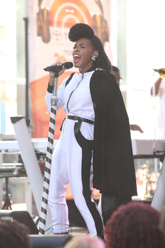 Janelle performing onstage over the summer