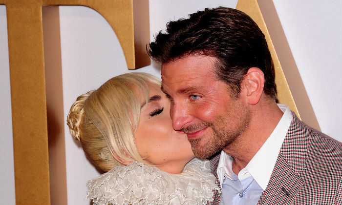 Lady Gaga and Bradley Cooper at the premiere of A Star Is Born (Photo Credit: Maurice Clements/Famous)