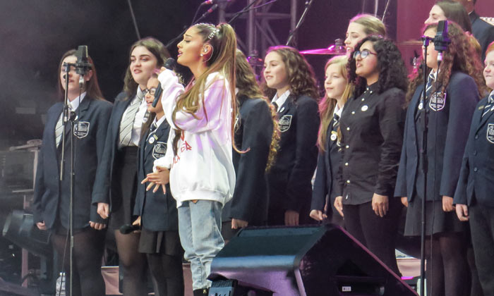 Ariana Grande performs with a children's choir