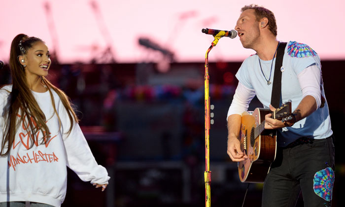 Ariana Grande performing 'Don't Look Back In Anger' with Chris Martin