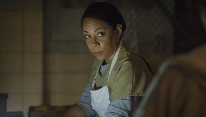 Gloria continues her work in the prison kitchen