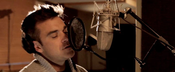 Robbie Williams recording He Ain't Heavy Still