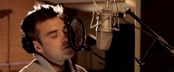 Robbie Williams recording He Ain't Heavy Still