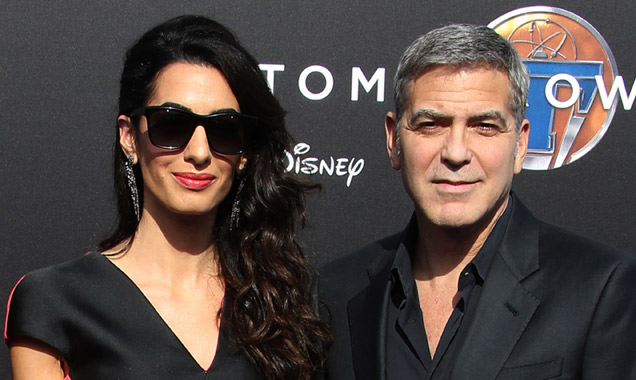 Amal Clooney and George Clooney at Tomorrowland premiere
