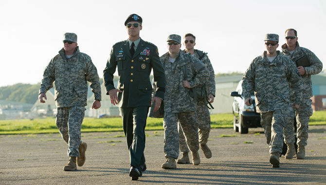 Brad Pitt and co-stars including Topher Grace in War Machine