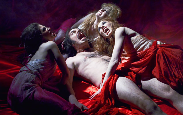 The succubi and Jemaine Clement in 'What We Do In The Shadows'