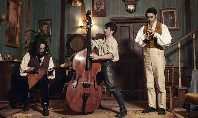 Jemaine Clement, Taika Waititi and Jonathan Brugh play instruments in 'What We Do In The Shadows'