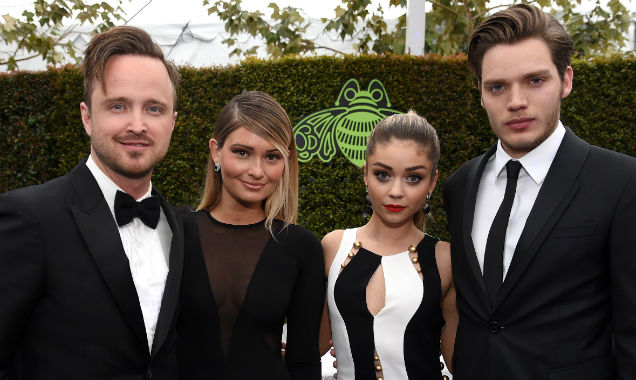 Aaron Paul, Lauren Parsekian, Sarah Hyland and Dominic Sherwood pose together (Credit Dimitrios Kambouris - Getty Images)
