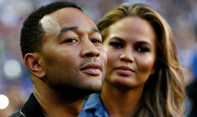 John Legend and Chrissy Teigen attend the 2015 Super Bowl (Credit Kevin C. Cox - Getty Images)