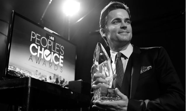 Matt Bomer with the 'Favourite Cable TV Actor' award at the 41st People's Choice Awards (Credit Frazer Harrison - Getty Images)
