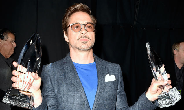 Robert Downey Jr. with his awards at the 41st People's Choice Awards (Credit Frazer Harrison - Getty Images)