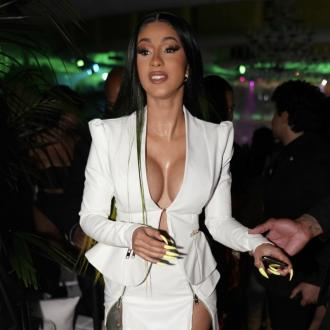 Cardi B outbids herself at charity auction