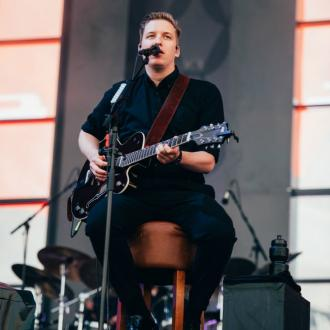 George Ezra plays Isle of Wight festival from chair after leg injury