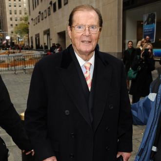 Sir Roger Moore's daughter believes he's visiting her from beyond the grave