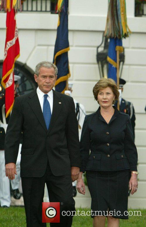 President George W. Bush and Mrs. Laura Bush...