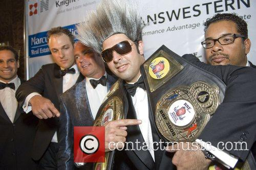 Promoter David Goldberg, second from right, shows off...