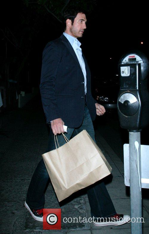 The ER hunk leaves Il Sole restaurant after...