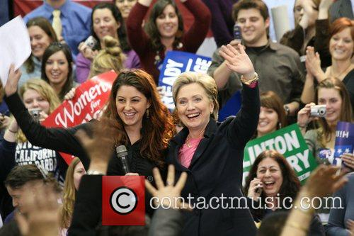 Presidential hopeful Hillary Clinton is welcomed by Associated...