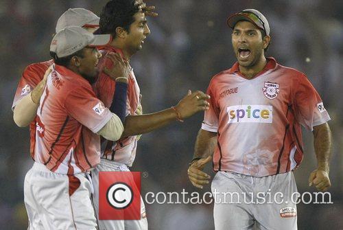 Kings XI Punjab captain Yuvraj Singh and teammates...