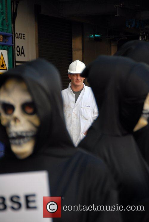 Protesters from PETA wore skull masks and dressed...
