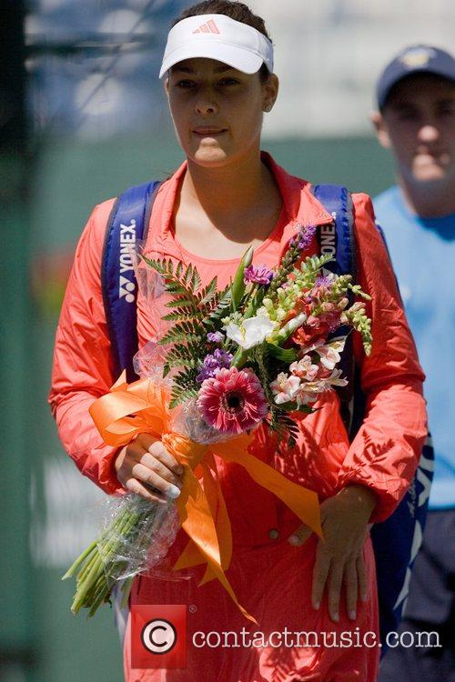 Ana Ivanovic(srb)  receives a bouquet after defeating...