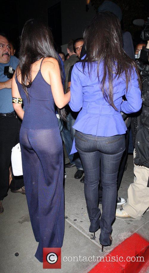 Kourtney Kardashian and her sister Kim Kardashian arrive...