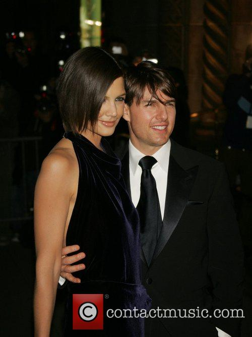 Katie Holmes and Tom Cruise attending his black-tie...