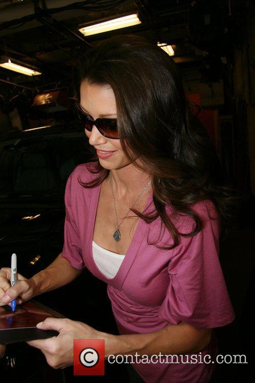 Shannon Elizabeth signing autographs outside ABC studios after...