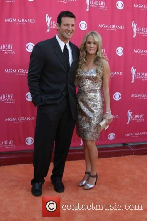 Tony Romo and Carrie Underwood The Academy of...