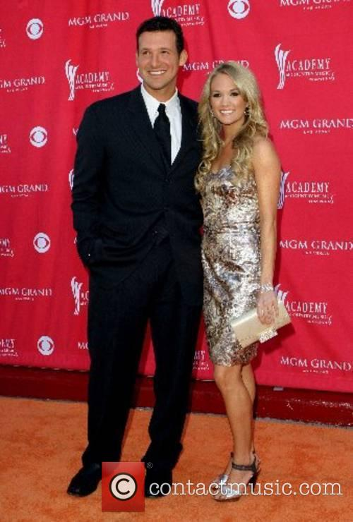 Tony Romo and Carrie Underwood 42nd Annual ACM...