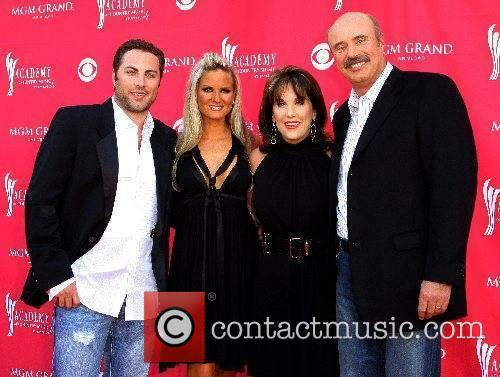 Jay McGraw and wife with Dr. Phil and...