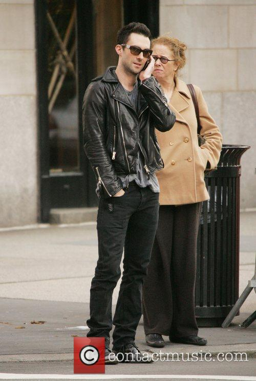 Adam Levine from band 'Maroon Five' walking and...