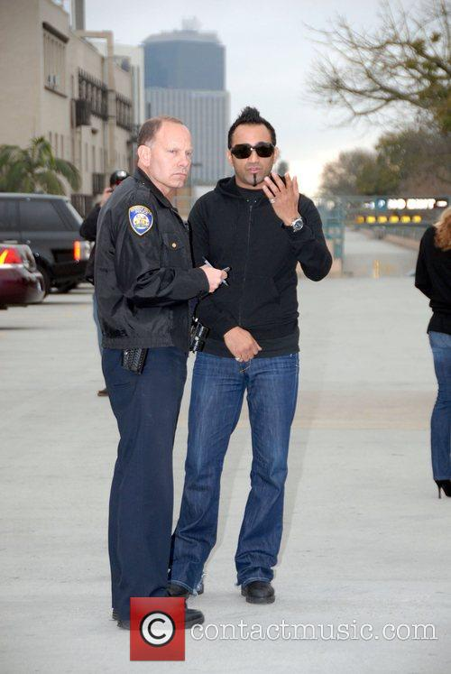 Is questioned by officers from the Beverly Hills...