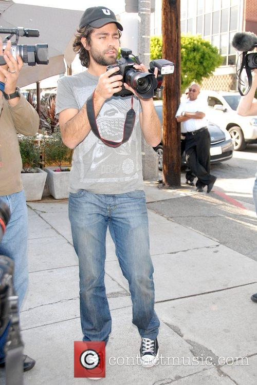 Tries his hand at being a paparazzo in...