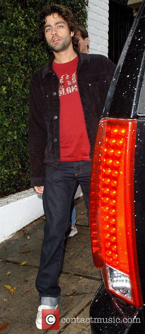 HBO's Entourage star Adrian Grenier leaving his house