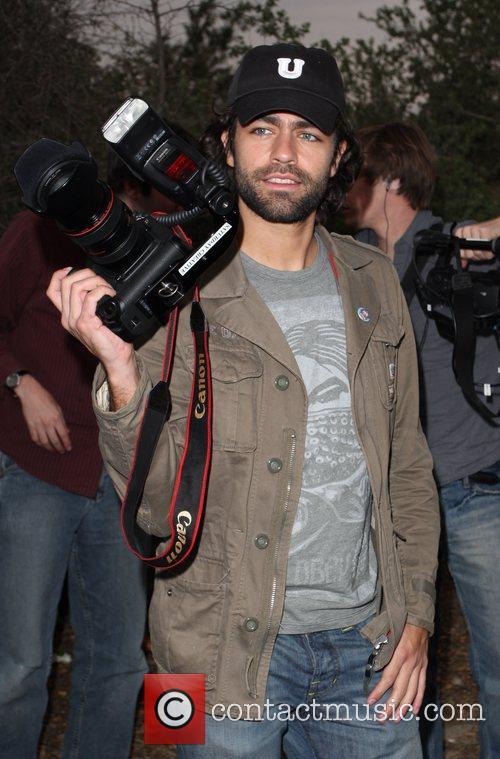 Adrian Grenier filming a documentary on how Celebrities...