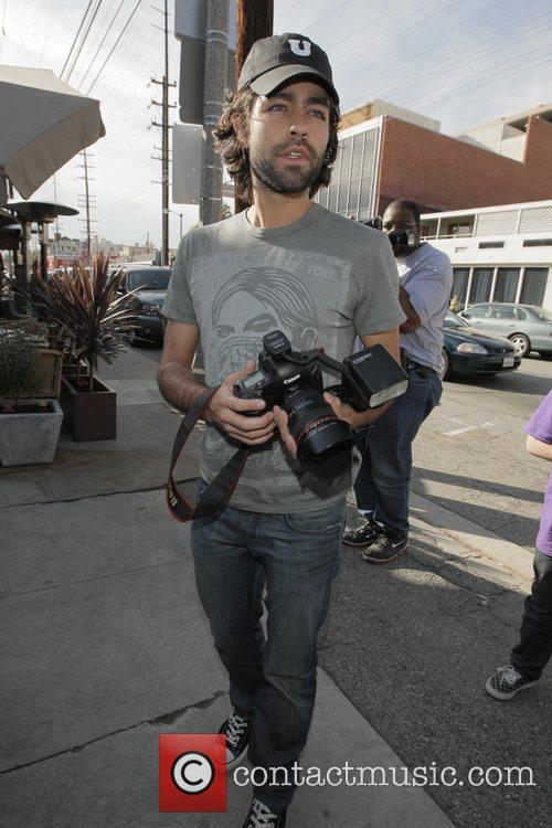 Adrian Grenier filming a documentary on how Celebrities...