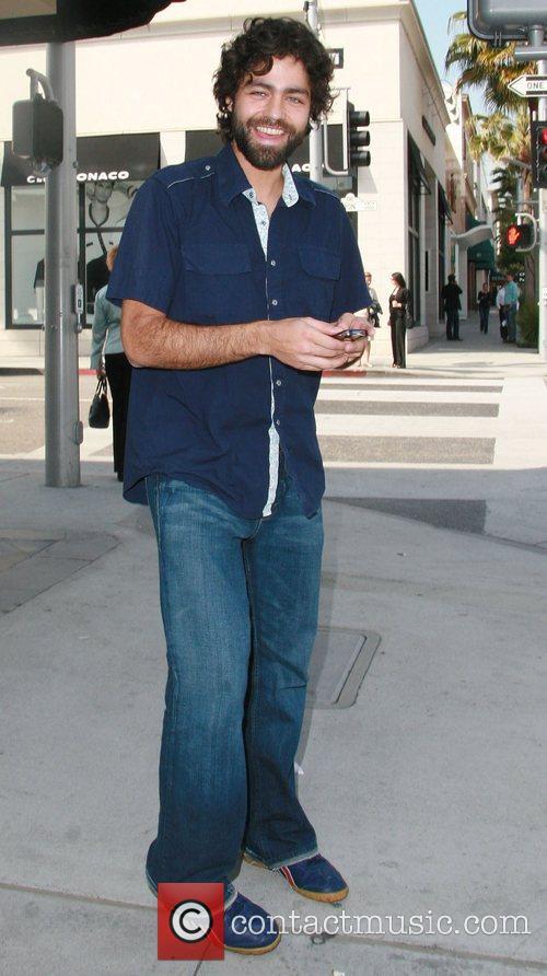 Entourage's Adrian Grenier in high spirits while walking...