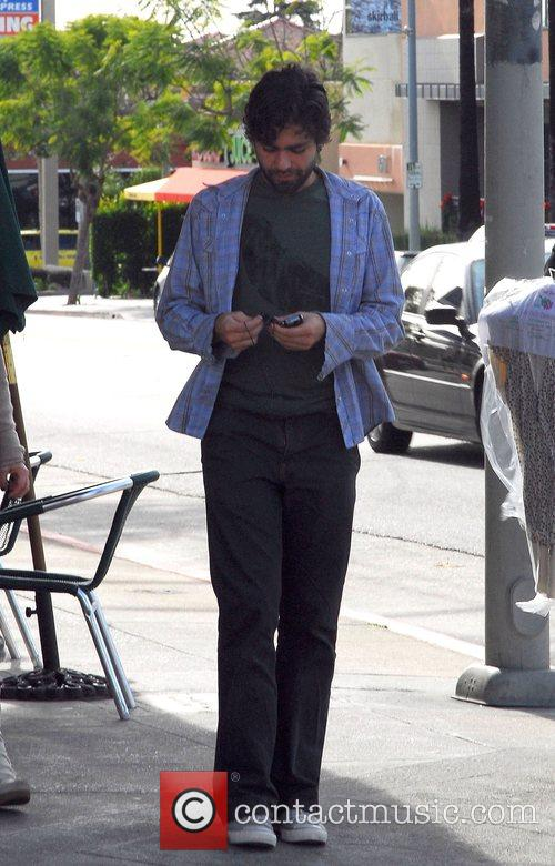 Adrian Grenier leaving a cafe after having breakfast...