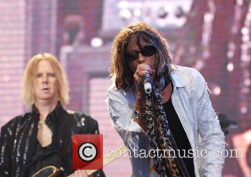 Steven Tyler and Tom Hamilton of Aerosmith performing...