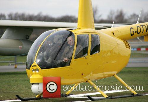 Sir David Jason arriving by Robinsons R22 helicopter...