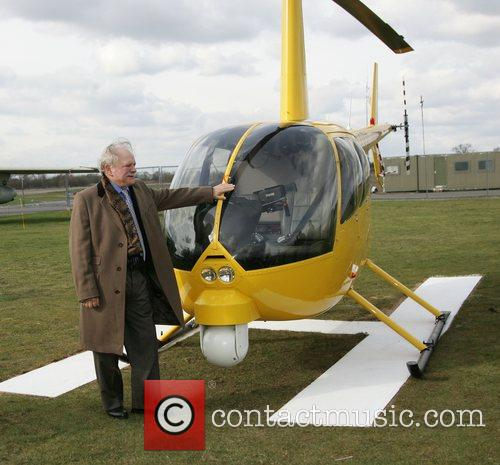 david jason standing by a robinsons r22 helicopter 1797260