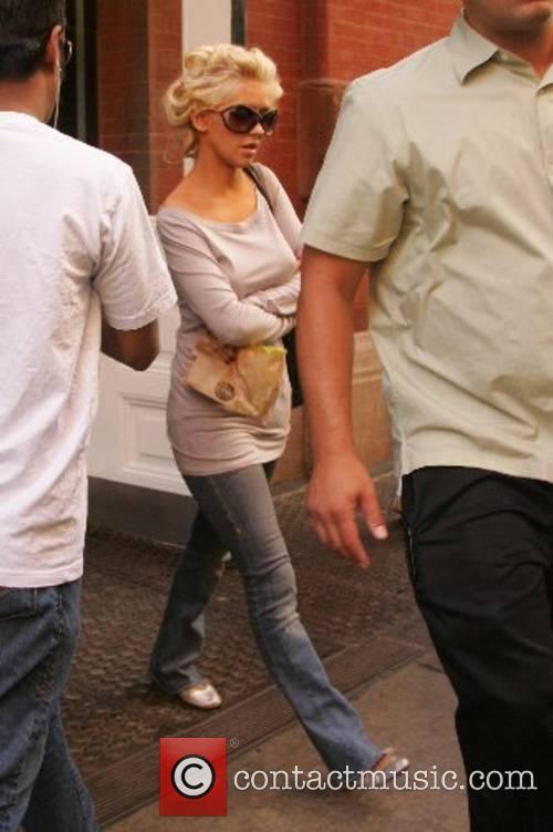 Christina Aguilera leaves her hotel in a mauve...